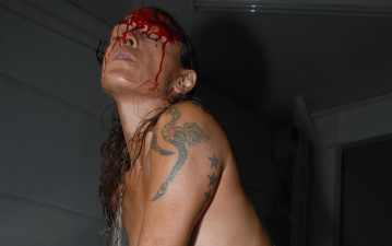Julie Tolentino, THE SKY REMAINS THE SAME: Ron Athey's Self Obliteration # 1, 2011. Performance. Photo: Thomas Qualmann